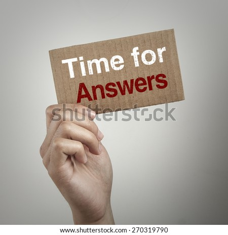 Hand with brown card is showing Time for answers with gray background. - stock photo