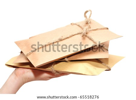 hand with brown paper parcels isolated on white - stock photo