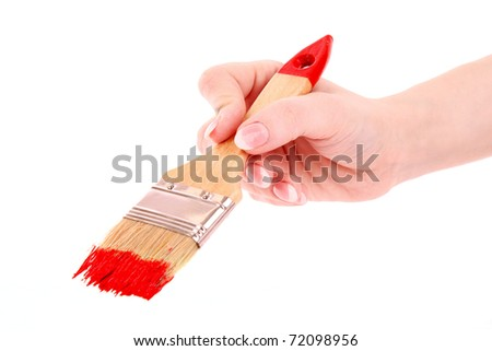 Hand with brush and red paint isolated on white