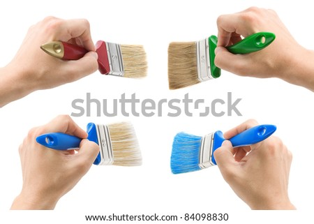 hand with brush isolated on white background - stock photo
