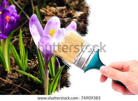 Hand with brush painting natural image with flowers. Spring concept. - stock photo