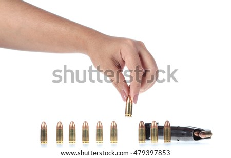 hand with bullet isolated on white background.