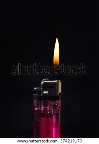Hand with Burning lighter - stock photo