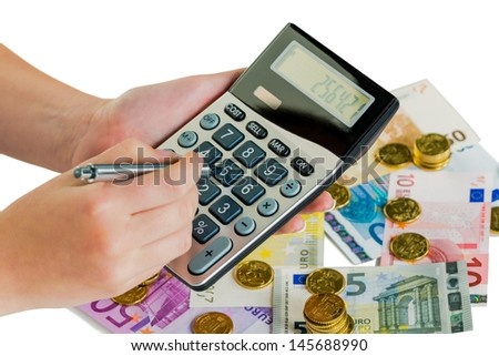 hand with calculator and bills. symbolic photo for revenue, profit, taxes and costing - stock photo