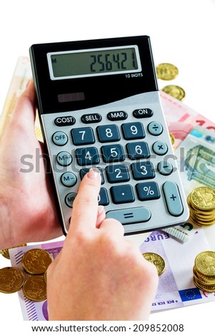 hand with calculator and bills. symbolic photo for turnover, profit, taxes and costing - stock photo