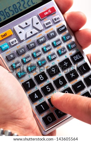 Hand with calculator. Finance and accounting business. - stock photo