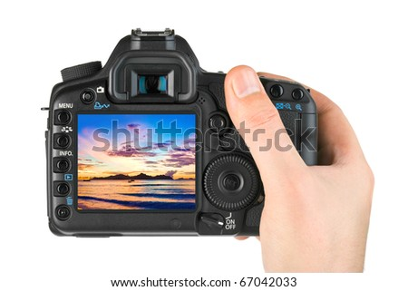 Hand with camera and beach landscape (my photo) isolated on white background - stock photo