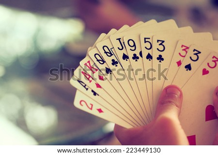 hand with cards vintage color tone - stock photo