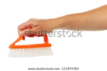 Hand with cleaning brush isolated on white background - stock photo