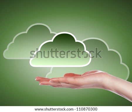 Hand with cloud computing symbol against colour background