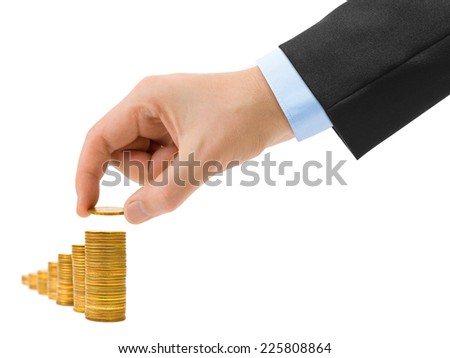 Hand with coin and money stairs isolated on white background - stock photo