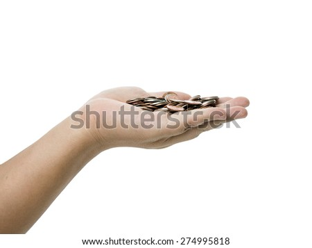 hand with coin isolated against a white background  - stock photo