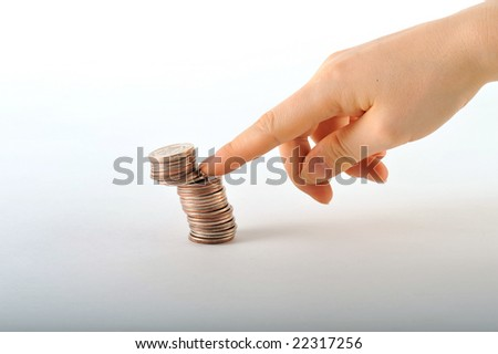 Hand with coins - stock photo
