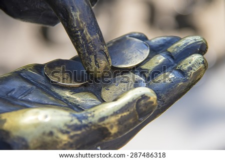 hand with coins at the dummy - stock photo