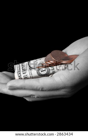 hand with coins colored, concept of looking after the small change - stock photo