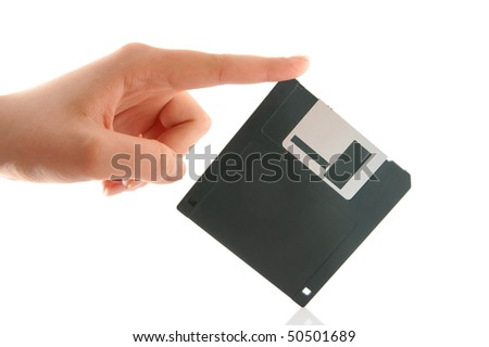 Hand with computer floppy disk isolated on white background