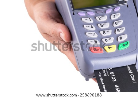 Hand with Credit card machine isolated on white background - stock photo