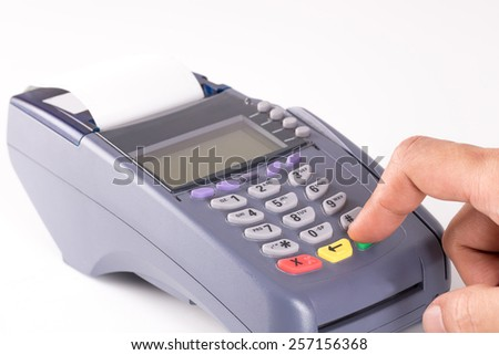 Hand With Credit Card Machine On White Background - stock photo