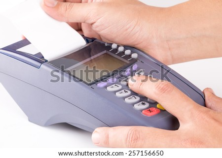 Hand With Credit Card Swipe Through Terminal For Sale On White Background - stock photo