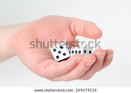 Hand with dice. - stock photo