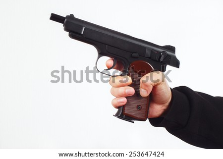 Hand with discharged semi-automatic gun on a white background - stock photo