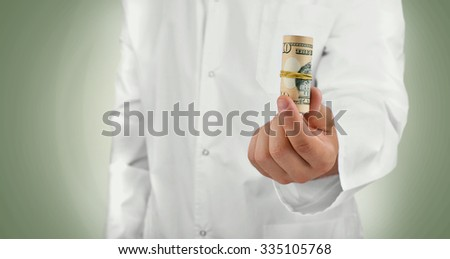 Hand with dollars on green background