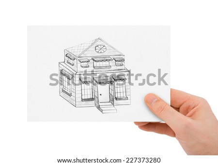 Hand with drawing house isolated on white background - stock photo