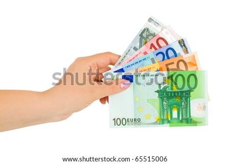 Hand with euro money isolated on white background - stock photo