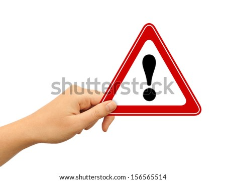 Hand with exclamation sign - stock photo