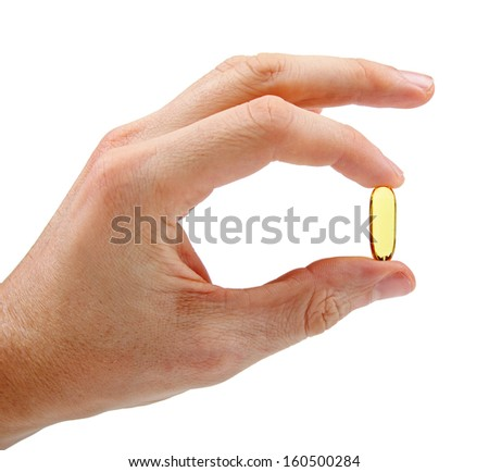 hand with fish oil capsule isolated on white - stock photo