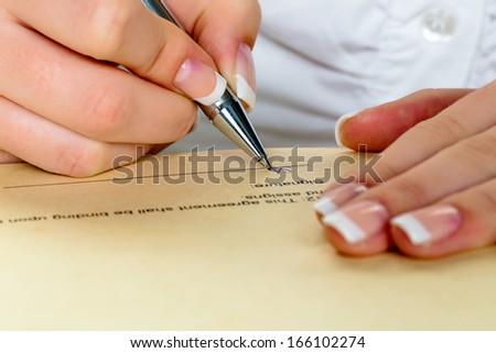 hand with fountain pen signing contract. sign woman while - stock photo
