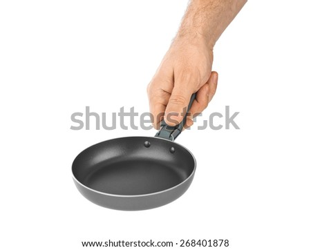 Hand with frying pan isolated on white background - stock photo