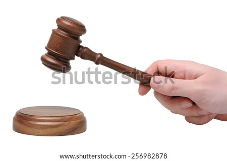 Hand with gavel on a white background