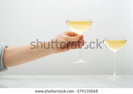 hand with glass of champagne