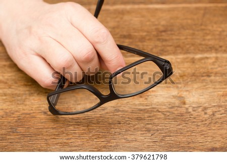Hand with glasses
