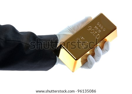 hand with glove holding a gold bar