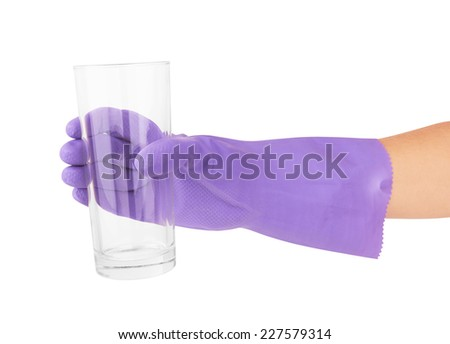 Hand with glove holding clean glass isolated on white background. - stock photo