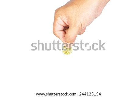 hand with golden coin isolated on white. - stock photo