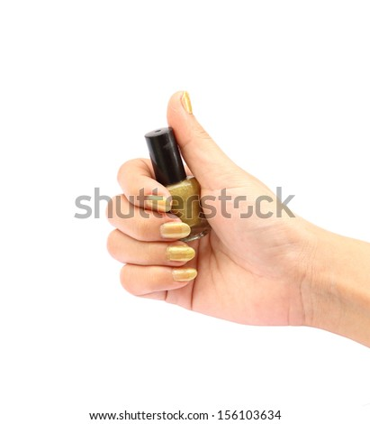 hand with golden nail polish bottle on white background (with clipping path)