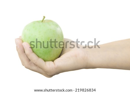 Hand with green apple isolated on white background - stock photo