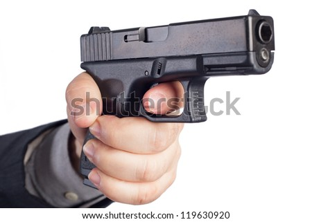 Hand with gun - stock photo