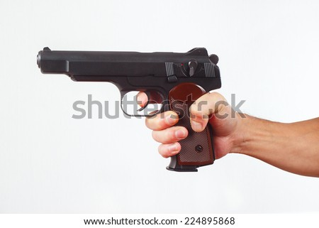 Hand with gun on a white background - stock photo