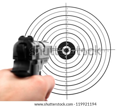 hand with gun shooting target - stock photo