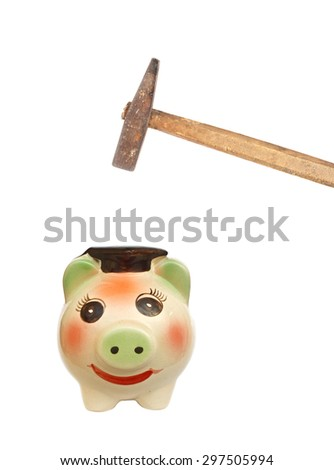 Hand with hammer about to smash piggy bank to get at savings on white - stock photo
