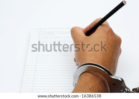hand with handcuffs close up - stock photo