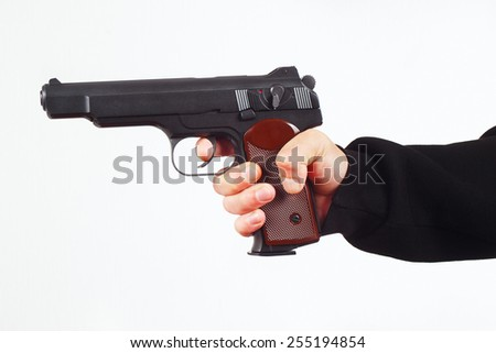 Hand with handgun on a white background - stock photo