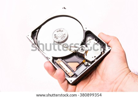 hand with hard disk isolated on white background - stock photo