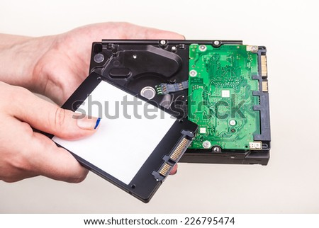 Hand with hard drives - stock photo