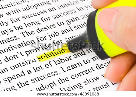 Hand with highlighter and word solution - concept business background - stock photo