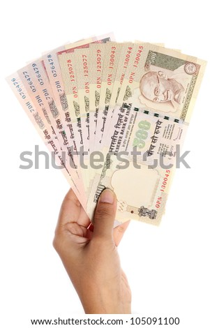 Hand with Indian rupee notes - stock photo